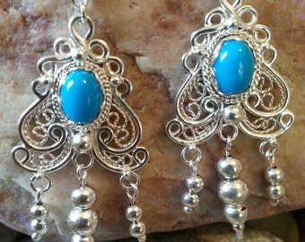 Handcrafted artisan sterling silver filigree earrings with Sleeping Beauty 8x6 turquoise  gemstones.