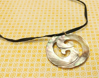 Carved Waves on Mother of Pearl Shell Pendant on Black Silk Cord With Antiqued Gold-Plated Brass Clasp and Hardware