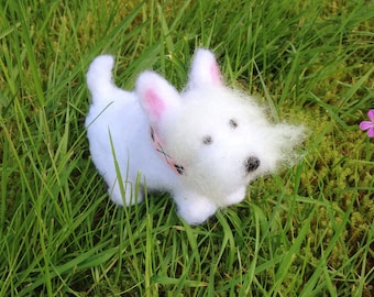 Miniature westie figurine wearing a pink argyle collar
