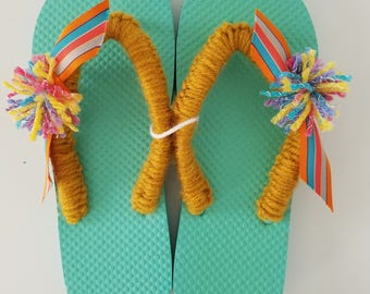 Ladies/Women Foam Green Flip Flops with Gold Crocheted Straps,Striped Ribbon and Multi Colored Pom Poms