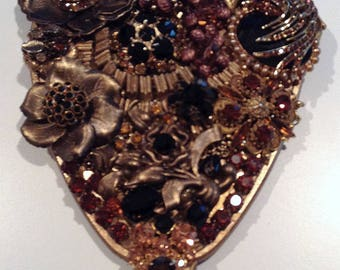 Plush and dramatic vintage hand held mirror with amber, black and gold jewels