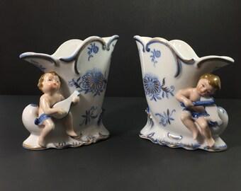 Cornucopia pair of Vases with Putti Ceramic Cherub Figures