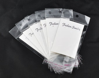 "100 Self-Seal Bags with Earring Display Card and Hang Tag size 10.8x6cm (4-1/4"" x 2-3/8"") bulk cello jewelry baggies, cellophane bag bag0067"