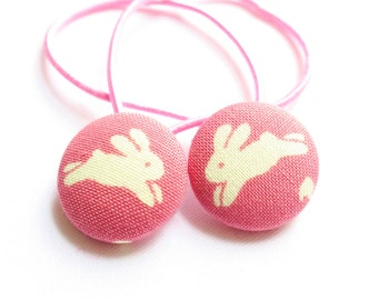 Cute bunny hair bobbles in pink. Perfect Spring or Easter gift for girls. Fabric buttons measure 23mm for ponytails, plaits and bunches.