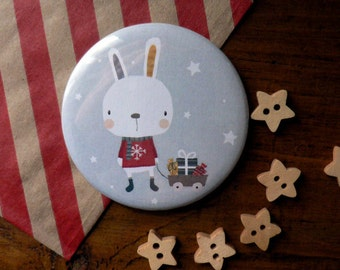 Magnet Featuring a little Christmas bunny with toys