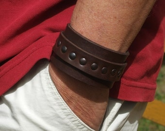 Leather bracelet with rivets and buckle,
