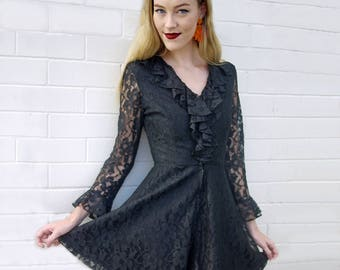 Black Lacey 1960s ruffle mini dress