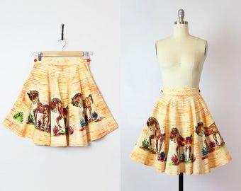 vintage 50s Mexican skirt / 1950s novelty print circle skirt / donkey burro skirt / souvenir skirt / short yellow orange cotton skirt