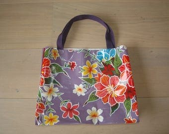 Purple and red plastic flowers bag