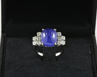 Iconic 9.70 Ct natural sapphire and 1.00 Ct diamond rare vintage ring