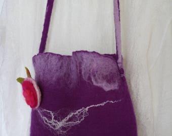 Purple wool felted bag with flower brooch.