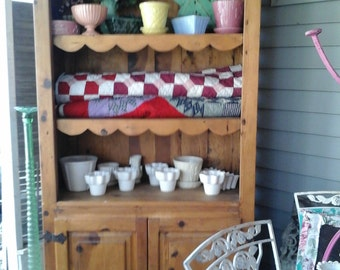 vintage pine cupboard with scallop