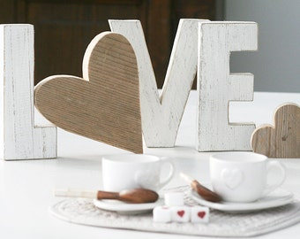 Reclaimed wood and written LOVE or heart-shaped