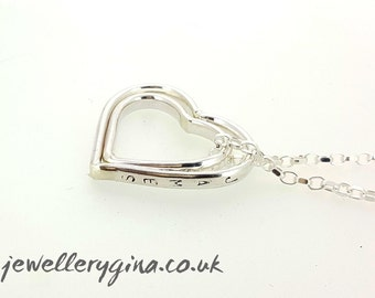 Personalised sterling silver heart necklace. A solid silver necklace with two pendant silver hearts hand-stamped with  a message or a date