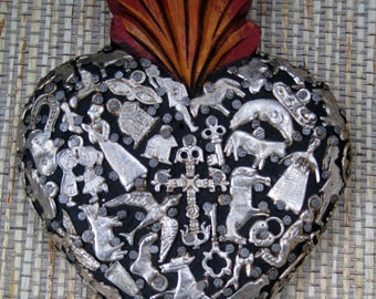 Mexican Flaming Wooden Heart Art Piece saturated with Milagros