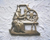 Vintage witch at spinning wheel, decoration, medallion, bottle opener, brass, collectible, save and buy group for 33