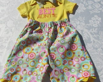 "Yellow bodysuit with ""i have the BEST AUNTIE"" on the bodice with capri pants and headband"