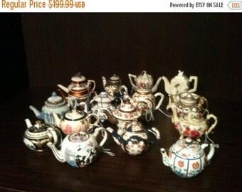 Collection of 16 mini tea pot by Nini