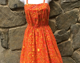 1970's Red and Mustard yellow Fit and Flare spaghetti strap dress with floral pattern