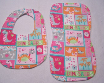 Pink dinosaurs and elephants infant, baby, toddler beautiful, modern bib and burp cloth sets.