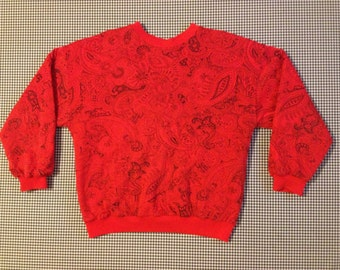 1980's, reversible, quilted, jersey knit pullover, in red and black paisley and polka-dots, Women's size Small