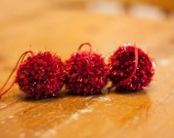 3 red tinsel pom-pom baubles