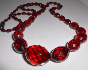 "Cherry Amber Faceted Graduating Opera Length Necklace 44 Grams 34"" Antique"