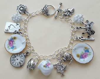 Alice in Wonderland bracelet, tea party theme, teapot, rabbit, key charms, vintage inspired china plates, silver chain