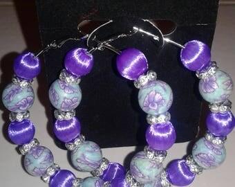 Purple and blue floral print hoop earrings.