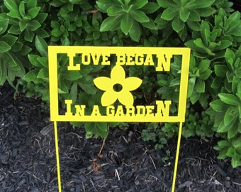 """Beautiful """"Love Began in a Garen""""  Stake that will add color to any garden"""