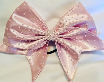 Powder pink or peach satin handsewn cheerbow with white pearls