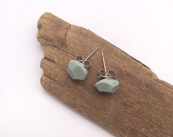 Organically faceted eco-resin earrings in concrete-inspired grey. With allergy-friendly surgical steel.