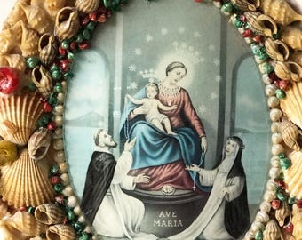 A very unusual vintage Italian religious artwork print in a frame adorned with sea shells