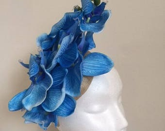 Stunning NEW blue orchid fascinator on a cream base with headband. One only!