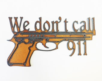 We Dont Call 911 sign made out of rusted metal