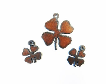 Clover Charm with matching earrings made out of rusted metal