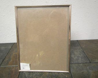 vintage 8 by 10 Antique Brass  picture frame with glass , free standing  {item #9P 8x10 }