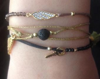 wing charm bracelet. gemstone bracelet. smokey quartz and waxed cord bracelet. delicate bracelet