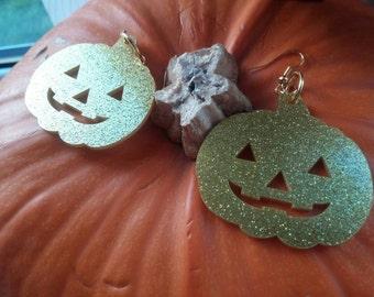 Golden pumpkin earrings.