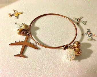 brass bracelet with nickel airplane charm and beads