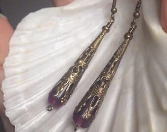 Bronze filigree earrings with purple bead