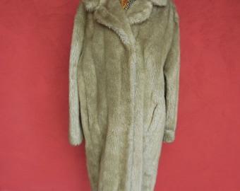 A vintage blonde fake fur coat 1950's