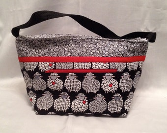 """Deeper Lunch Bag: """"Ewe Will Love It"""" washable insulated lunch bag with a zipper front pocket and zippered top closure."""