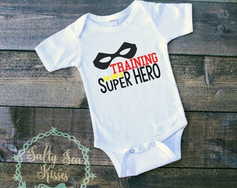 Training to be a Super Hero - Baby Bodysuit - Super Hero Baby Bodysuit
