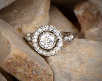 Platinum and old European cut Diamond Halo Engagement Ring