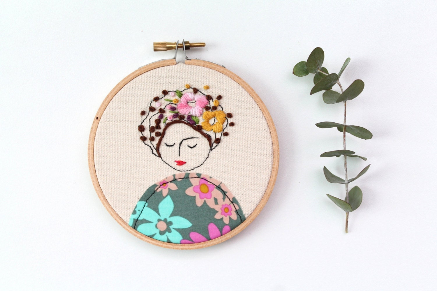 Embroidery hoop art embroidered illustration of a girl hand