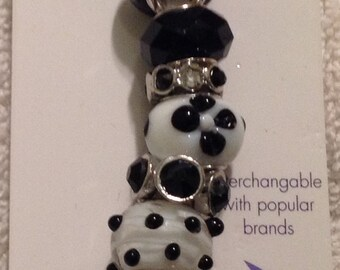 Darnice 9 piece Mix and Mingle Black and White Glass Metal Lined Beads....Interchangeable with Popular Brand Bracelets..... NEW