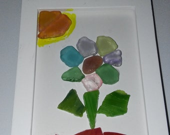 Seaglass picture of flower multicolored with sun and soil picture