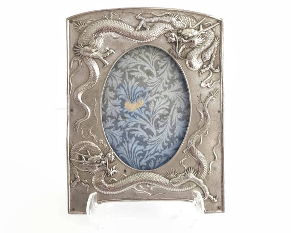 Silver plated photo frame with 2 dragons in relief, hand hammered metal, ferocious creatures, lovely details, Japan, 7 x 5.25 inches, 1930s