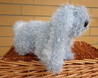 Tinsel bunny rabbit knitted in silver with white inner ears, front and tail.